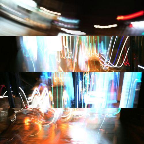 Digital composite image of light trails on table at restaurant
