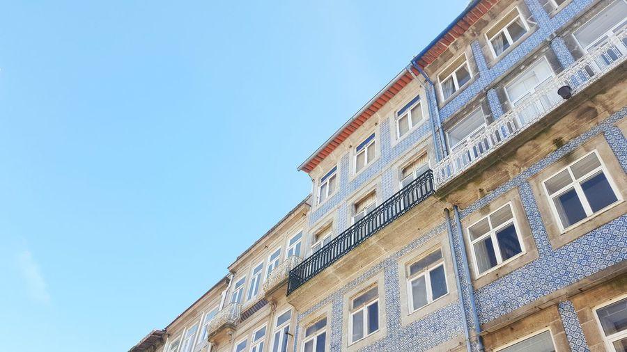 Blue facades with tiles in Porto, Portugal Typical Tiles House Front View Blue Tiles Porto Portugal Copy Space Free Space Feburary Spring Sunny Blue Sky Façade Decorative Art Row House Townhouse