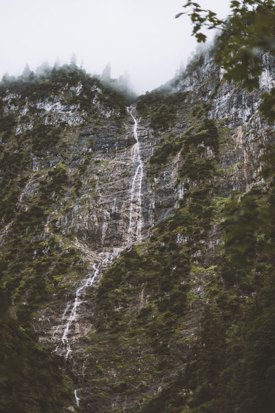 Lost In The Landscape Beauty In Nature Cliff Day Low Angle View Motion Mountain Nature No People Outdoors Power In Nature Scenics Sky Tree Water Waterfall