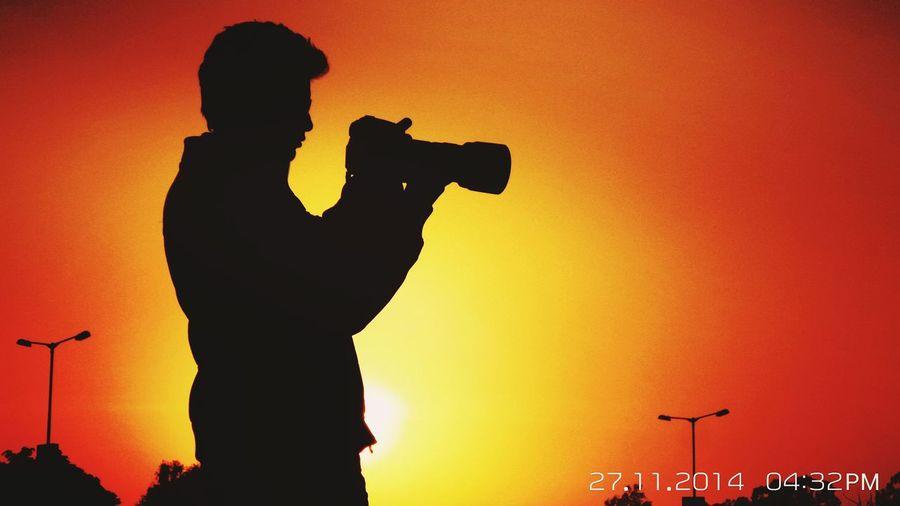 Capturing nature's beauty Sunset Silhouette Orange Color Standing Men Lifestyles Three Quarter Length Sun Sky Outdoors Creativity Vibrant Color Scenics First Eyeem Photo