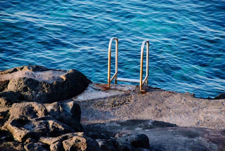 Water Sea Nature Beach Day Rock High Angle View Tranquility Beauty In Nature No People Rock - Object Ladder Tranquil Scene Idyllic Outdoors Scenics - Nature