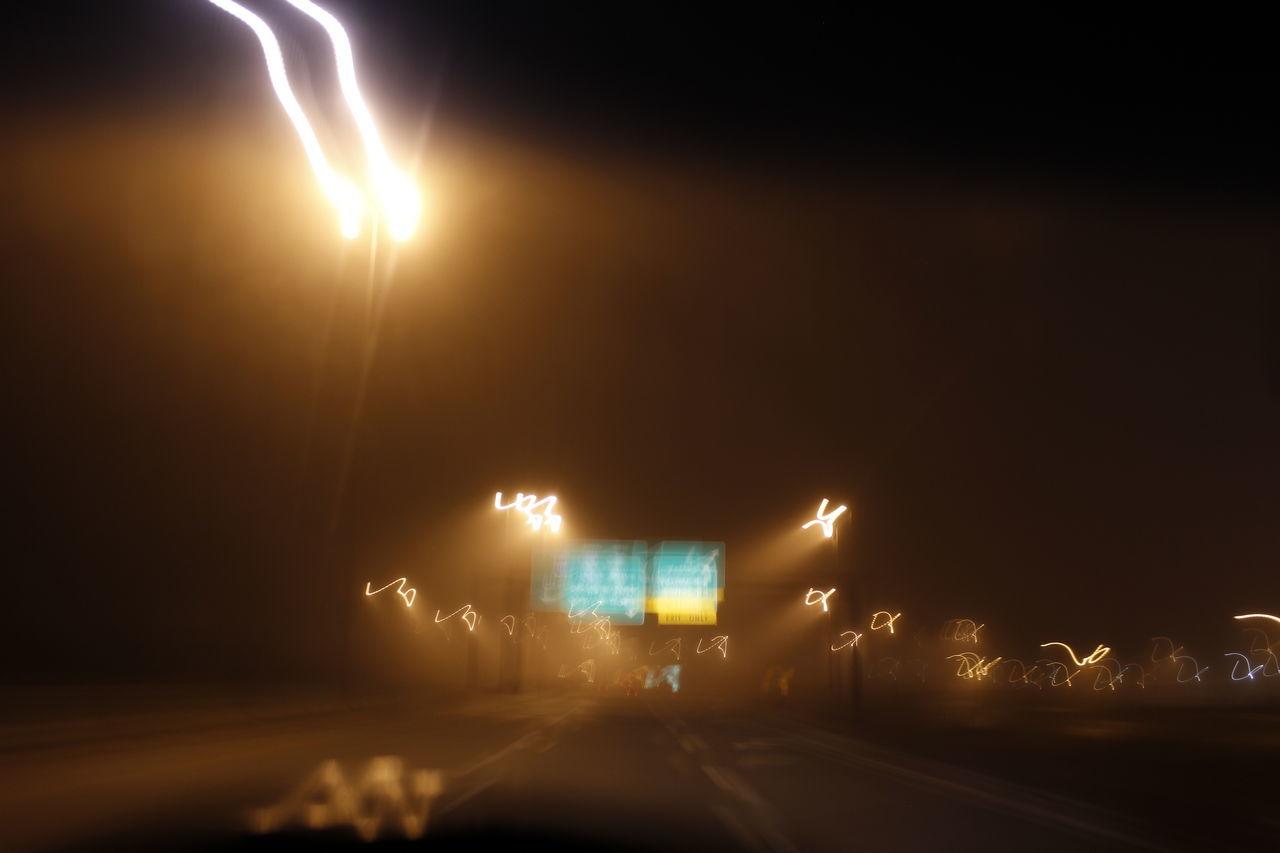 illuminated, night, lens flare, transportation, speed, road, sky, no people, outdoors, light trail, street light, sunset, nature