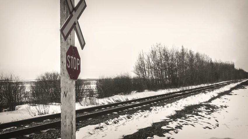 Winter Snow Rail Transportation Transportation Railroad Track Crossing Stop Sign Uncontrolled Journey No People Prairies Train Tracks