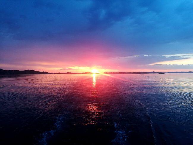 Norwegian Summernight Sailorslife Midnight Sun Norway Nature Sunset Sunset_madness Boknafjorden Water Sea Sunset Dramatic Sky Wave Moody Sky Atmospheric Mood