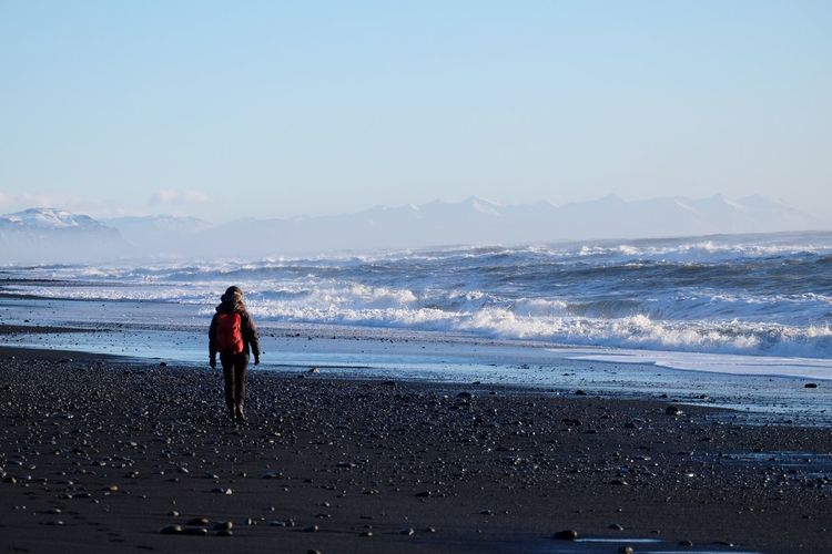 Beach Sea Wave Sand One Person Full Length Nature Beauty In Nature Water Real People Leisure Activity Scenics Horizon Over Water Sky Lifestyles Vacations Outdoors Day Clear Sky Standing Blacksandbeach Vik