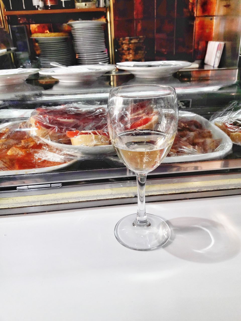 food and drink, glass, freshness, food, glass - material, alcohol, transparent, drink, indoors, refreshment, no people, wine, wineglass, table, still life, ready-to-eat, household equipment, restaurant, close-up, business, temptation, red wine