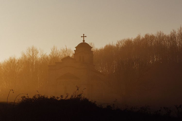 Church in the sunset Architecture Built Structure Religion Spirituality Belief Place Of Worship Outdoors Nature Sunset Fog Church Orthodox Church Serbia