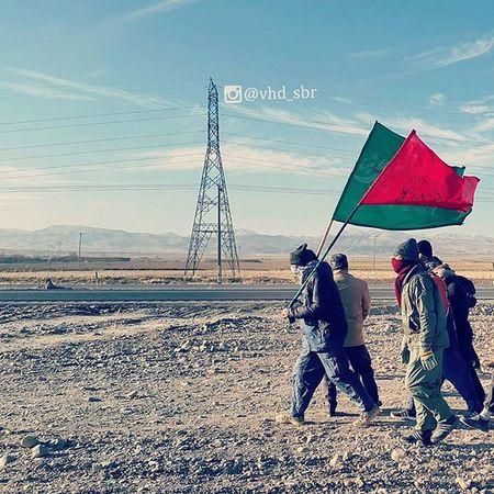 ▫ به کسی که جلوتر از همه حرکت می کنه و پرچم دستشه، میگن پرچمدار (یا علمدار )، دوتا پرچم هست با این متن: صل الله علیک یا علی بن موسی الرضا. یکی قرمز و دیگری سبز پرچمدار همیشه جلوتر از بقیه حرکت می کنه و کسی حق نداره ازشون جلو بزنه. ضمنا بهتره پشت پرچمدار به صف حرکت بشه. علم ها معمولا خیلی سنگینن، برداشتنشون حتی واسه چند دقیقه دست رو خسته می کنه. علم برداشتن حس خاصی داره که نمیشه توصیفش کرد. علمدار_کربلا طوری علمو نگهداشته بود که میگن چوب علم همه جاش جای نیزه و شمشیر و خط وخش بود جز جایی که دست حضرت گرفته بودش... . پرچمو_زمین_نذاری پرچم_بالاست پرچم 😚 Flag Flagofislam Flagkeeper Pilgrims walking a distance of 205km to reach Imam Reza's holy shrine for his martyrdom anniversary. Khorasan_e_Razavi , Iran Mashhadlive Everydayiran Everydaymiddleeast Everydayasia Everydayeverywhere پیاده_روی_تا_مشهد پیاده_روی_مشهد اللهم_ارزقنا_زیارت_الاربعین قمر_بنی_هاشم ماه ماه_بنی_هاشم ساقی سقا حضرت_ماه اند_معرفت اند_ادب ادب داداش_نه_مولا