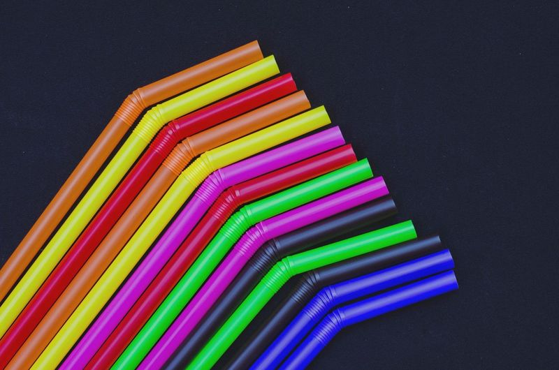 High angle view of multi colored pencils on table against black background