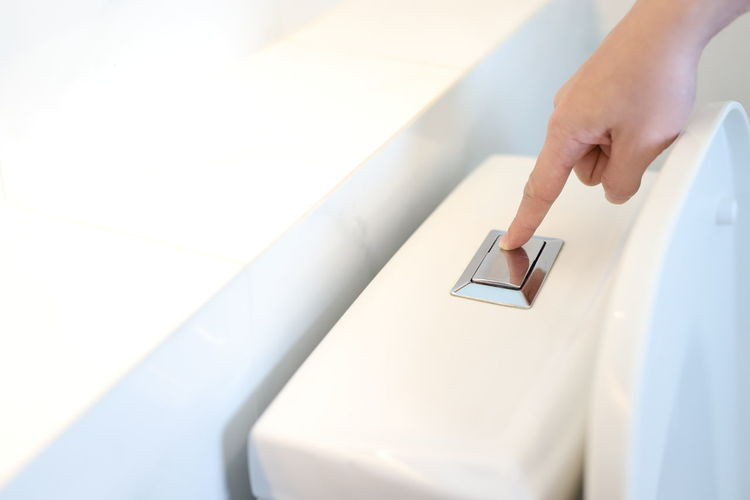 Cropped hand of woman pressing button