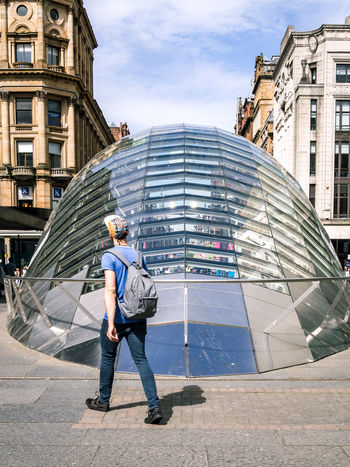 Walking Around The City  From Behind Glasgow  Scotland Transport Architecture Building Built Structure Casual Clothing City Day Full Length Leisure Activity Lifestyles Modern One Person Outdoors Real People St Enoch Standing Streetphotography Subway Station Summer Holiday Traveller Young Man