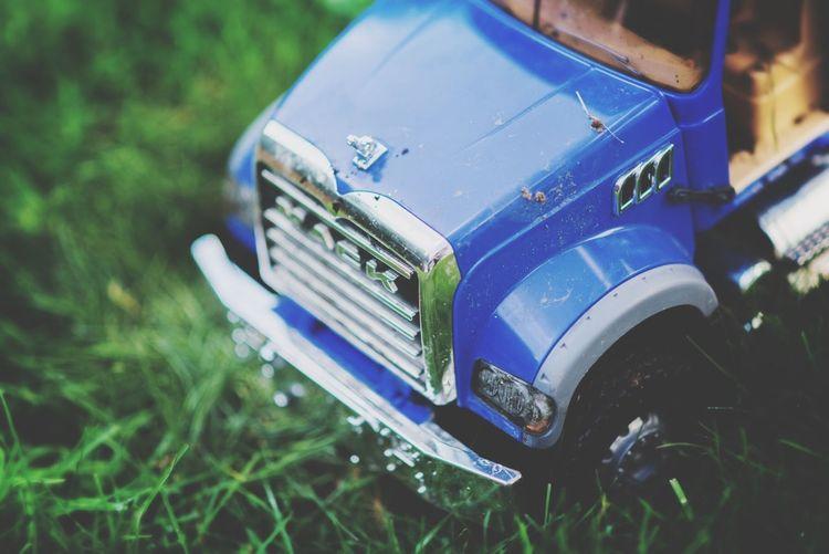 Truck in the grass. Toys Mack Truck Grass Green Blue