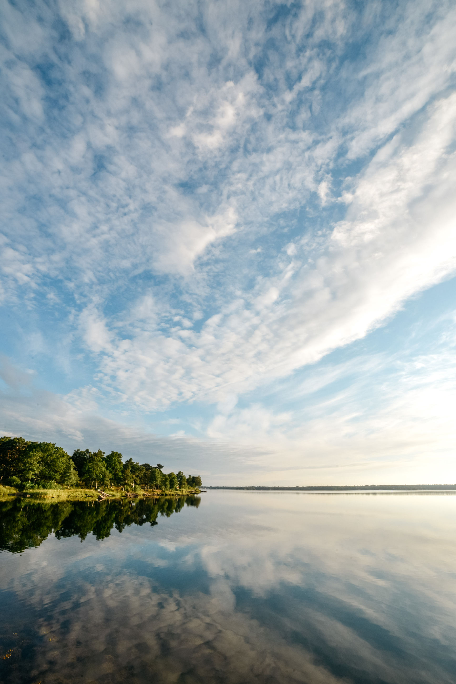 sky, cloud - sky, water, scenics - nature, tranquility, reflection, tranquil scene, beauty in nature, lake, nature, waterfront, no people, idyllic, non-urban scene, tree, day, plant, outdoors, reflection lake