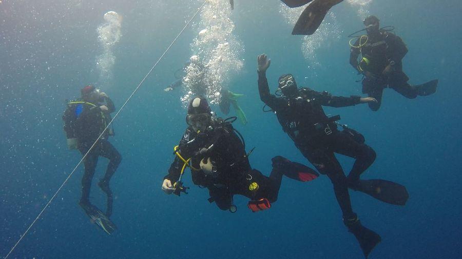 People scuba diving in sea
