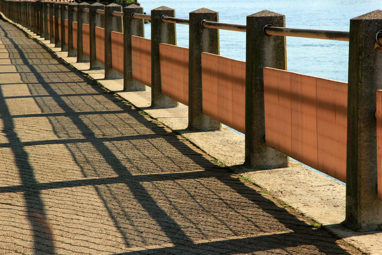 Design By Shadows Railing By The Water Day Guard Rail No People Outdoors Shadow Sunlight Water Waterfront
