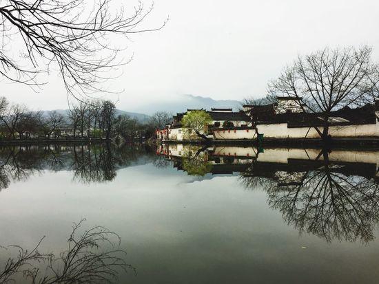 "Mirror village of Hongchun where ""Crouching Tiger Hidden Dragon"" was filmed Reflection Lake Village Crouchingtiger Water Architecture China No People Chinesevillage Mirrorlake Scenics Landscape"