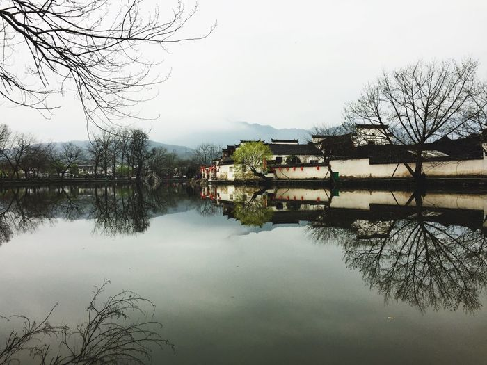 "Mirror village of Hongchun where ""Crouching Tiger Hidden Dragon"" was filmed Reflection Lake Village Crouchingtiger Water Architecture China No People Chinesevillage Mirrorlake Scenics Landscape"