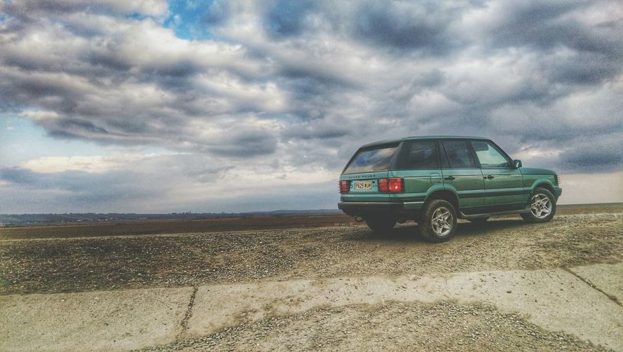 Car Cloud - Sky Weather Travel Transportation Nature Sky Sunset Beauty In Nature Storm Cloud Dramatic Sky Scenics Power In Nature Outdoors Thunderstorm Landscape No People Survival Storm Beach Car Range Rover P38 Range Rover Adapted To The City