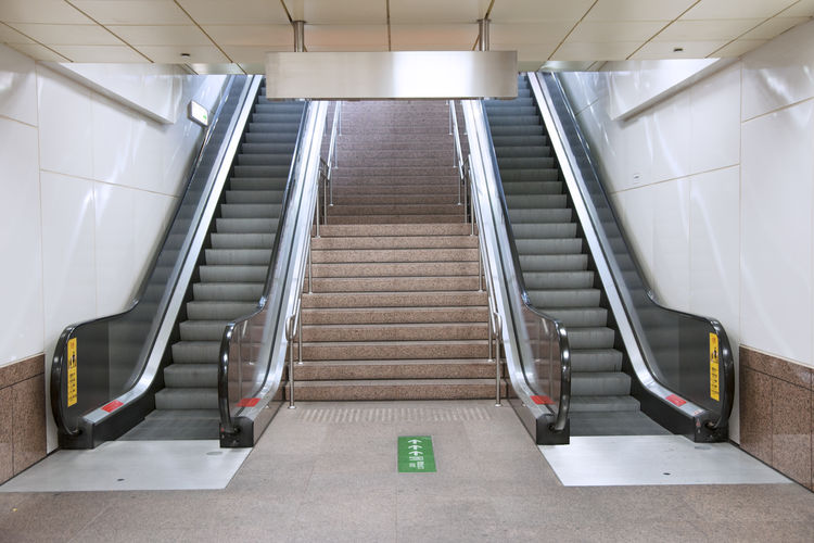 Staircase Steps And Staircases Indoors  Architecture Railing Escalator Convenience Empty Direction The Way Forward Absence Technology No People Low Angle View Illuminated Built Structure Metal Transportation Flooring Connection Modern Tiled Floor Automatic