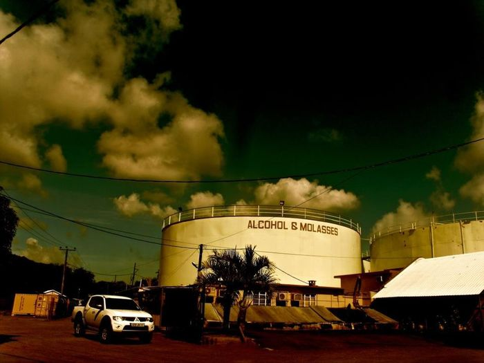 Africa Alcohol Cloud - Sky Clouds Electricity  Industy Molasses Night No People Outdoors Sepia Sky Storage Storage Tanks Storm Truck