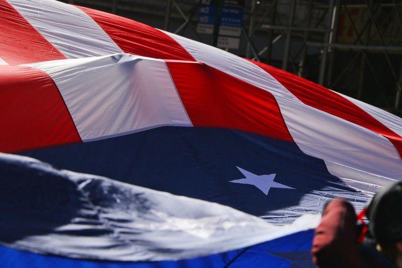 Hand holding cuban flag