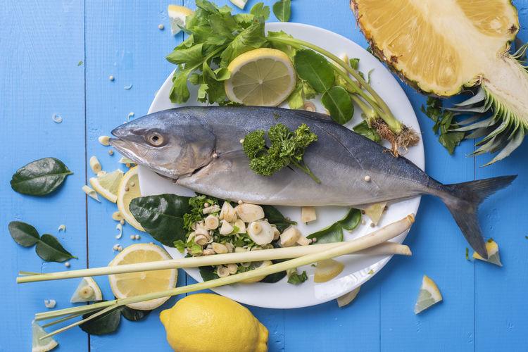 Blue Sea Food And Drink Pineapple Seafood Beach Blue Fish Food Food And Drink Freshness Fruit Healthy Eating Herb Indoors  Ingredient Lemon No People Omega 3 Raw Food Sea Sea Fish Spice Vegetable Wellbeing