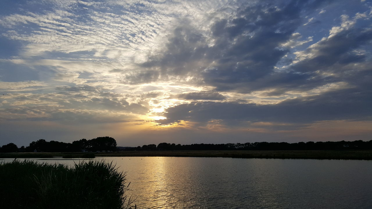 sunset, sky, cloud - sky, scenics, beauty in nature, nature, silhouette, tranquil scene, water, tranquility, reflection, tree, no people, lake, outdoors, waterfront, architecture, day
