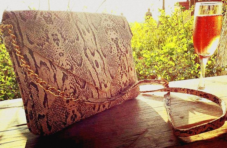 Free time Outdoors Nature Day No People Grass Bag Purse Animalprint Wine Relaxing Fashion Photography Fashion Close-up Handmade Handmade Accessories Leather Leather Bag Textured