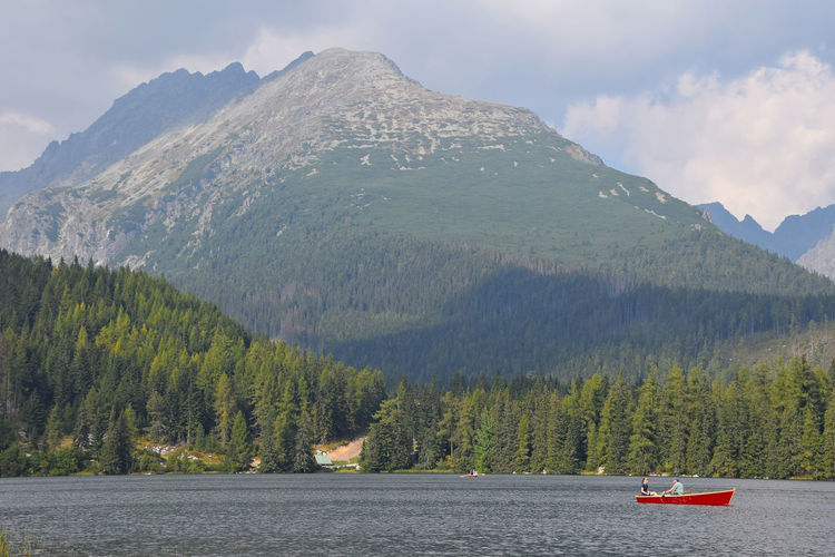 Couple boating at Strbske Pleso (Štrbské Pleso) mountain lake in Vysoke Tatry (High Tatras) mountains, Slovakia Alone Beauty In Nature Boat Boating Couple Forest Leisure Activity Lifestyles Mountain Range Nature Pull Remote Row Scenics Strbske Pleso Tatra Mountains Tatry Together Tranquil Scene Tranquility Tree Vacation Water Waterfront Lost In The Landscape