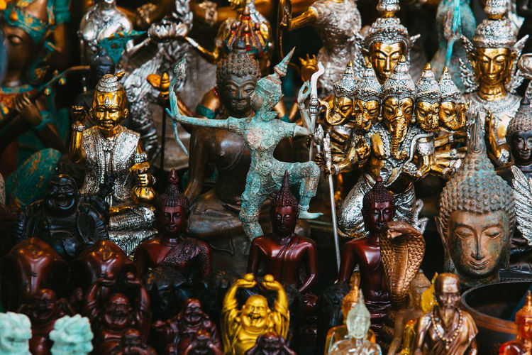 Close-up of statues for sale in store