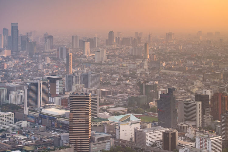 Bangkok City The Great Outdoors - 2018 EyeEm Awards The Architect - 2018 EyeEm Awards Bangkok Thailand City Cityscape Urban Skyline Skyscraper Modern Aerial View Downtown District Fog Sunset Sky Tower EyeEmNewHere
