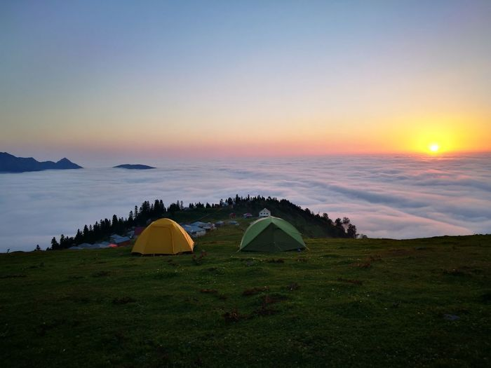 Scenic view of campground against sky during sunrise