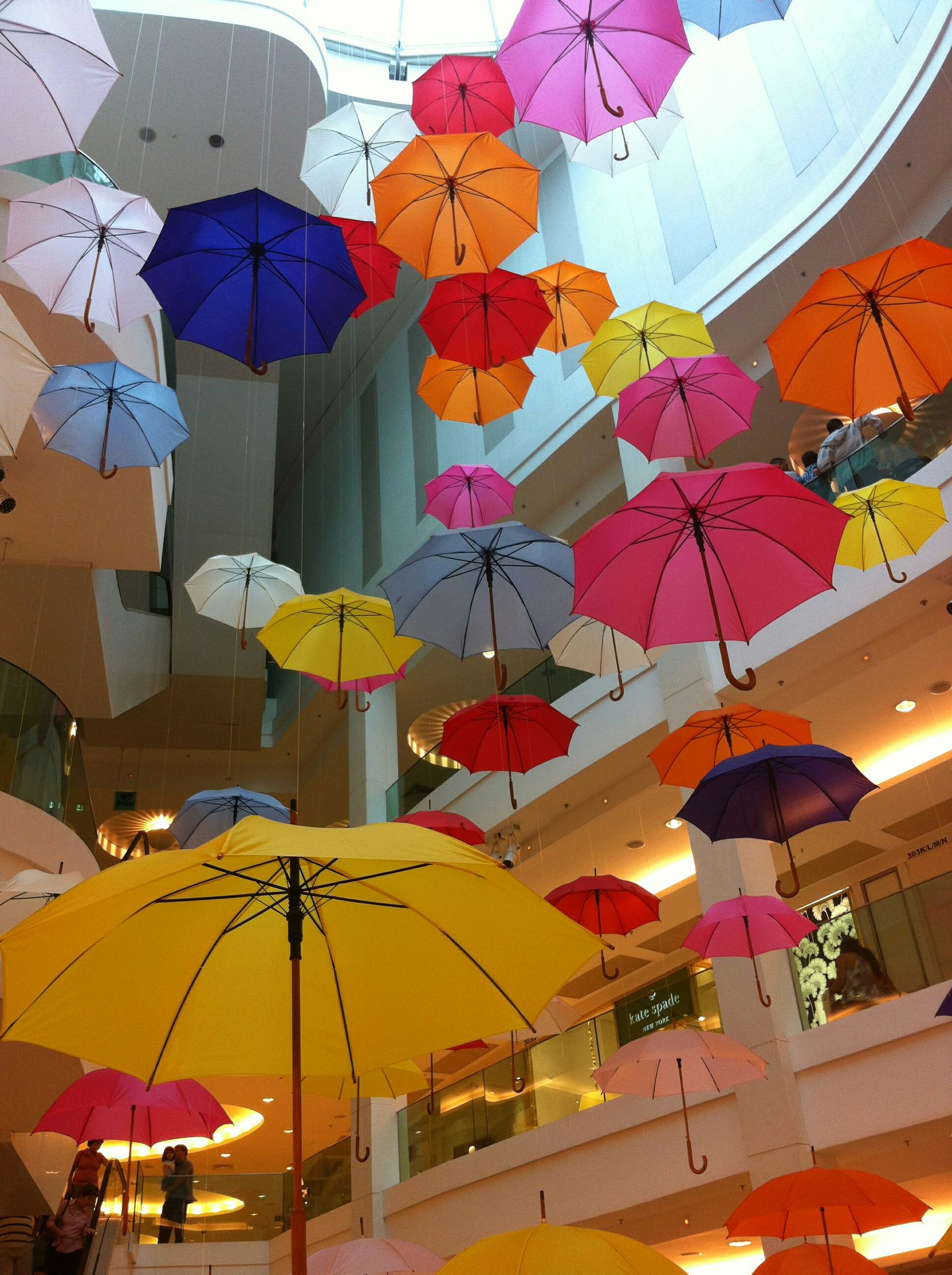 architecture, built structure, multi colored, low angle view, building exterior, decoration, hanging, umbrella, celebration, lighting equipment, indoors, ceiling, cultures, lantern, colorful, day, tradition, balloon, design