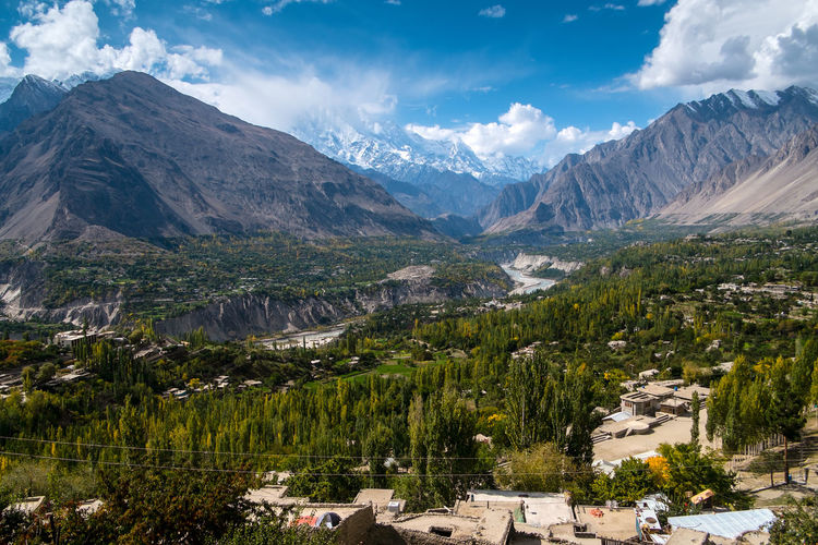 Peacefully Hunza-Nagar valley with a view of snow-capped Rakaposhi in Karakoram mountain range. Gilgit Baltistan, Pakistan. Pakistan Hunza Valley Gilgit Baltistan Travel Destinations Nagar Valley River Mountains Mountain Range Mountain Peak Rakaposhi Green City Aerial View Village Snow Capped Mountains Karakoram Forest Foliage Wild Wilderness Mountaineering Eco Tourism Cityscape Panoramic Landscape Panorama Climate Ecology Environment Countryside Famous Landmarks Beautiful Scenery Peaceful Peace And Quiet Serenity Beauty In Nature Scenics - Nature Tranquil Scene Architecture Tree Building Residential District No People Outdoors Day