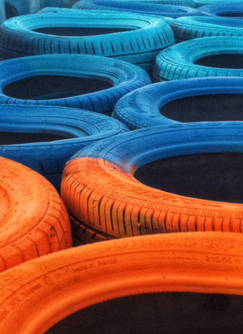 Paint Stack Textured  Textures And Surfaces Tires Wheel Background Backgrounds Blue Car Close-up Full Frame Garbage Heap Material No People Old Orange Color Pattern Recycling Rubber Tire Truck Tyre Used
