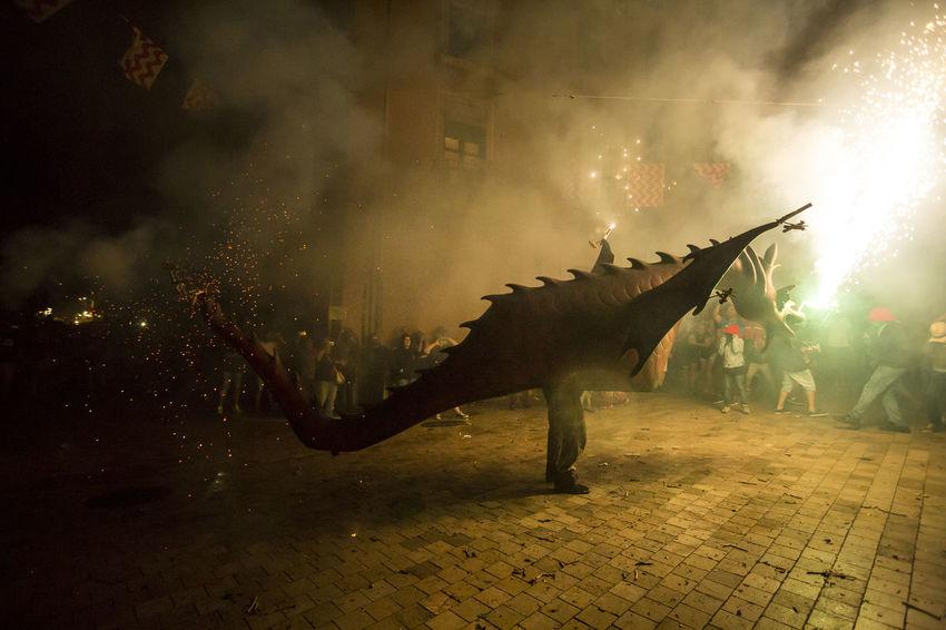Besties a les festes de Sant Roc 2016 Besties Catalonia Catalunya Celebration Crowd Culture Fire Firerun Fireworks Illuminated Men Night Outdoors Party Performance Road Sant Roc Selective Focus Spectator Street Traditional