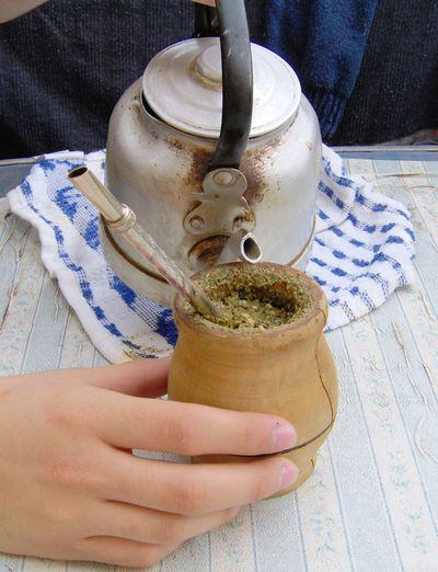 Close-Up Of Woman Hand Preparing Herbal Tea