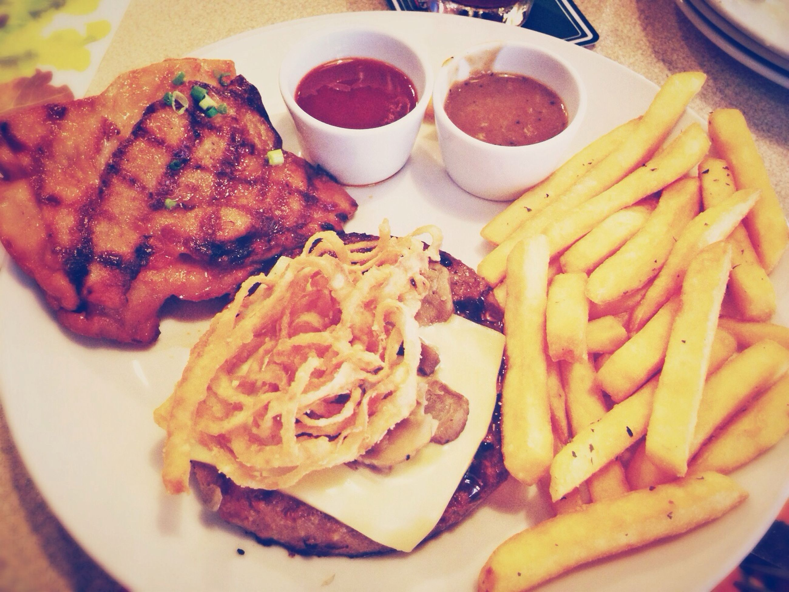 food and drink, food, freshness, ready-to-eat, indoors, plate, close-up, serving size, still life, meal, meat, french fries, healthy eating, indulgence, sauce, table, served, cooked, prepared potato