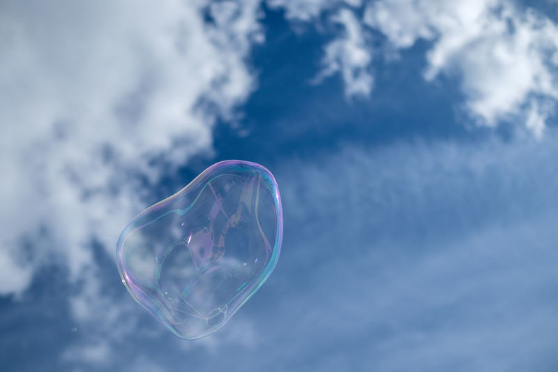 Low angle view of bubble in mid-air against sky