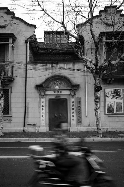 Architecture Built Structure Building Exterior Building Blurred Motion Motion City Transportation Street Arch Real People Mode Of Transportation Unrecognizable Person Land Vehicle Entrance Day One Person Outdoors Road Blackandwhite