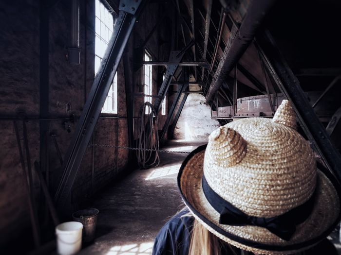 Close-Up Of Girl Wearing Hat In Old Warehouse