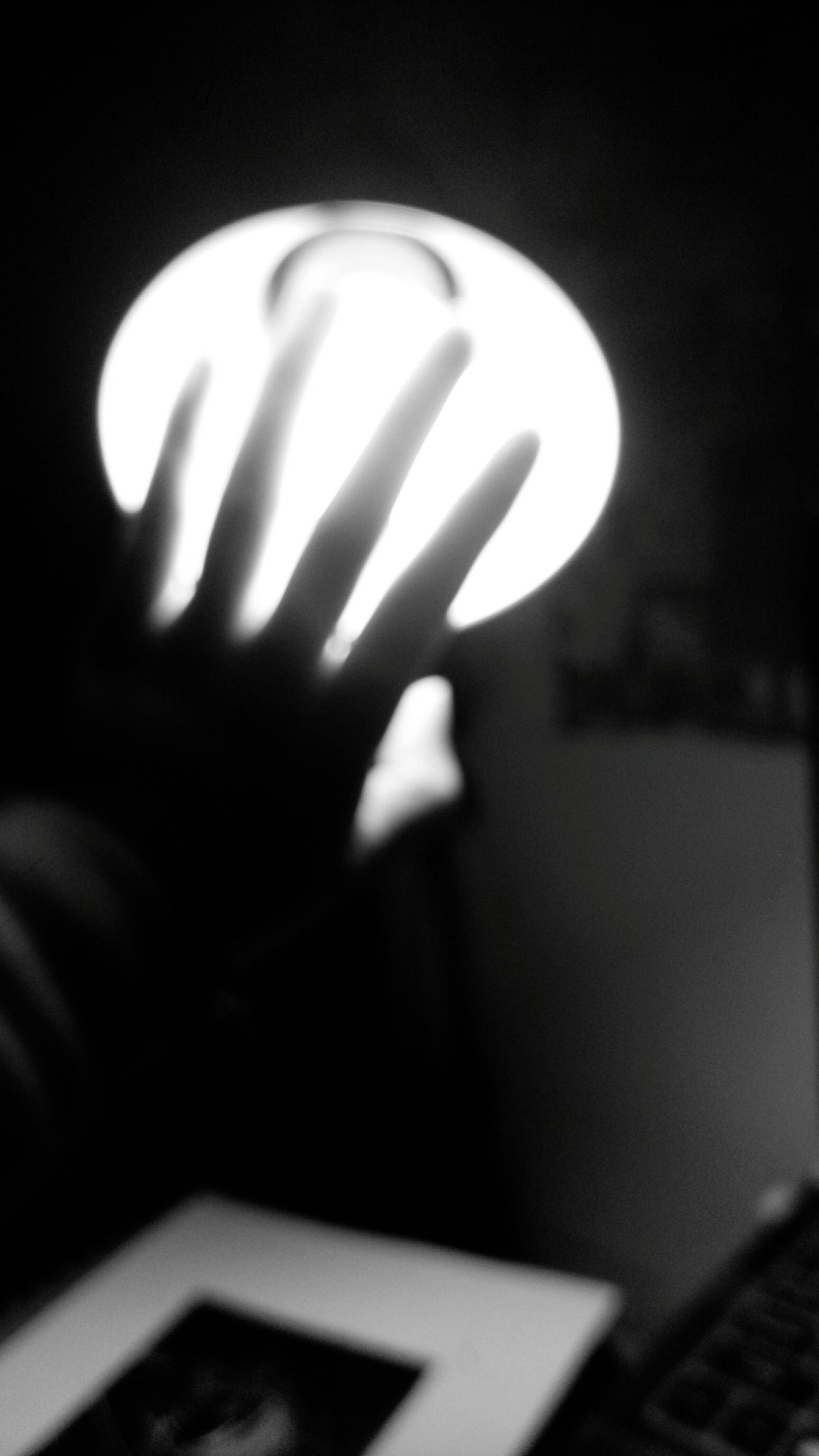 person, indoors, close-up, focus on foreground, part of, cropped, selective focus, human finger, unrecognizable person, communication, holding, defocused, night, dark, shadow, copy space, wall - building feature
