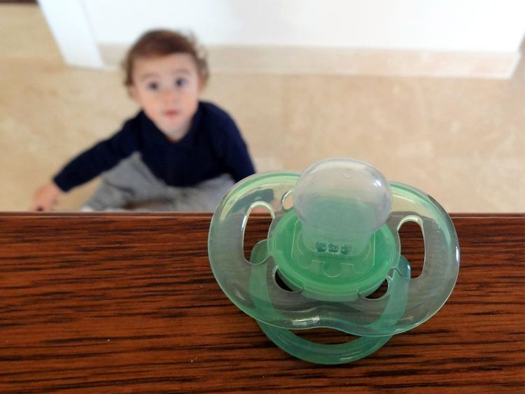 Baby Boy Child Childhood Close-up Dummy Focus On Foreground Front View Green Indoors  Infancy One Boy Only One Person Pacifier Seperation Unreachable
