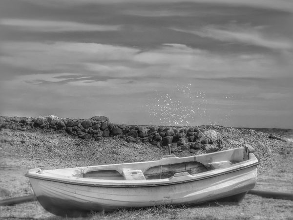 A lonely boat sitting on beach in Santorini Greece Black And White Cloud - Sky Nautical Vessel Outdoors Landscape Photography Santorini Island Fujifilm Hdr_captures Malephotographerofthemonth Santorini, Greece Black And White Photography Monochrome Photograhy Monochrome Photography MonochromePhotography Portrait_shots Coastal Beauty Boats That Floats Boats And Moorings Boats⛵️ Black And White Collection  Black And White Boat No People Close-up