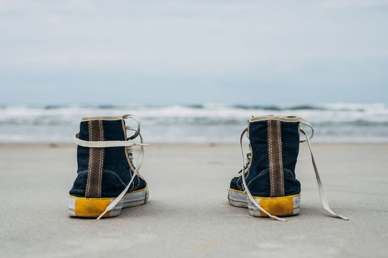 Sneakers on the beach Baltic Baltic Sea Beach Copy Space Cover Creative Focus On Foreground Friends Fun Happy Horizontal Composition Lonly Love Nature No People Outdoors Sea Sea And Sky Selective Focus Shoes Sky Sneakers Still Life Summertime View A New Perspective On Life