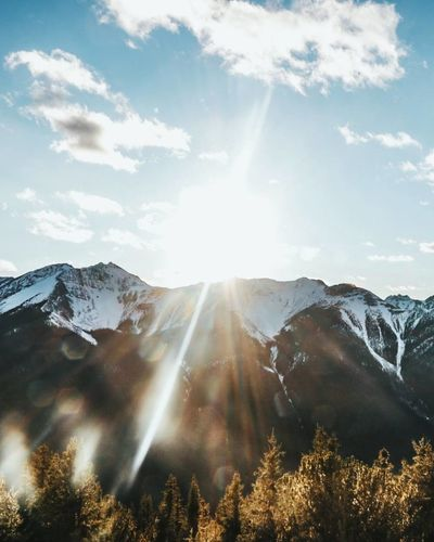 Beauty In Nature Bright Cold Temperature Day Landscape Lens Flare Mountain Mountain Range Nature No People Outdoors Scenics Sky Snow Sun Sunbeam Sunlight Sunny Tranquil Scene Tranquility Winter