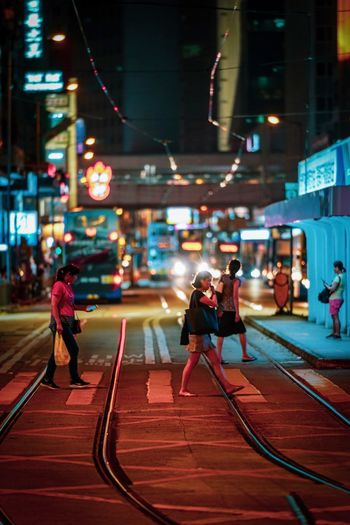 Hktramways Street Photography Nightshooters Discoverhongkong Reframinghk Night Illuminated City Transportation Architecture Street City Life Full Length Building Exterior People Lifestyles Group Of People Adult Built Structure City Street Road Walking Motion Outdoors Women
