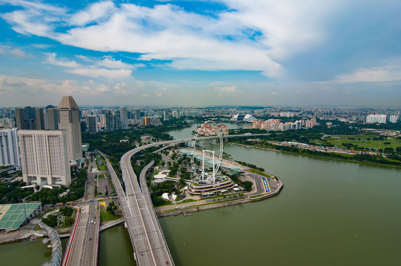 High angle view of bridge and buildings against sky