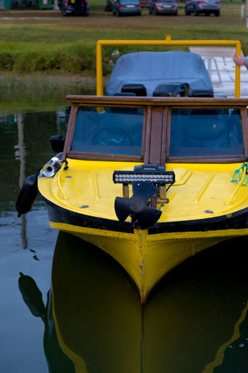 Yellow Transportation Mode Of Transportation Day Water No People Nautical Vessel Moored Nature Focus On Foreground Outdoors Close-up Lake Reflection Absence Travel High Angle View Plant