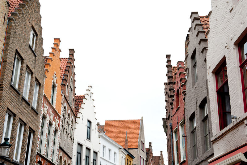 Tipical northern europe houses roof view from the street Apartment Architecture Belgium Building Exterior Built Structure City Clear Sky Day Low Angle View No People North Europe Outdoors Pitched Roof Roof Sky Tipycal Traditional Travel Destinations